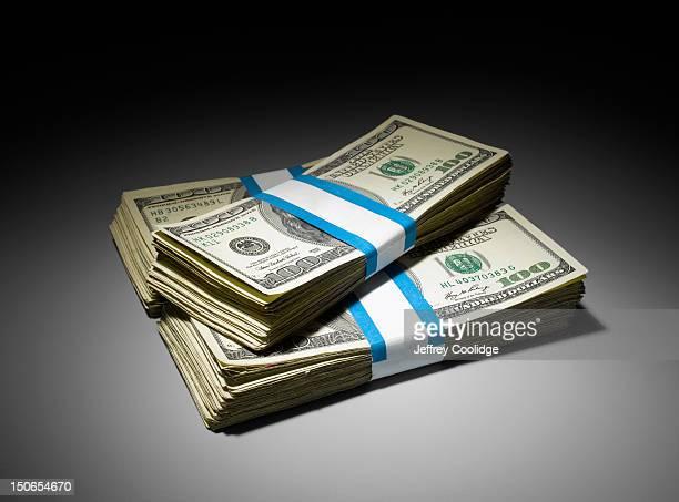 3 Stacks of $100 Dollar Bills