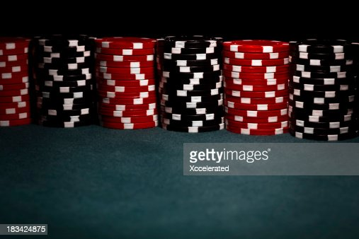 Stacks of black and red poker chips
