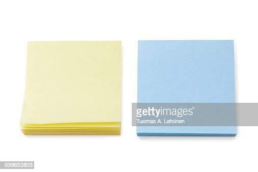 Stacks of blank yellow & blue post-it notes
