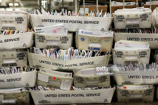 Stacks of boxes holding cards and letters are seen at the US Post Office sort center December 15 2008 in San Francisco California On its busiest day...