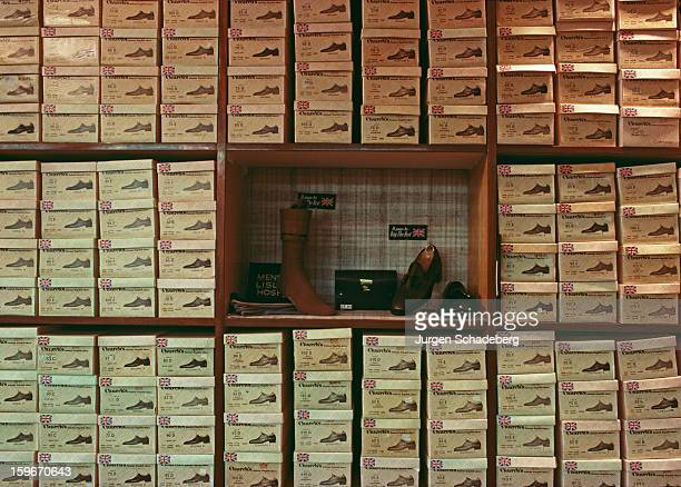 Stacks of Britishmade Church's shoes in a London shoe shop UK July 1981
