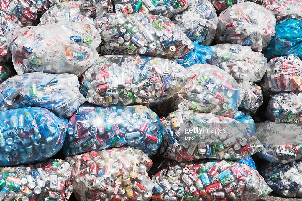 Stacks of cans in plastic bags : Stock Photo