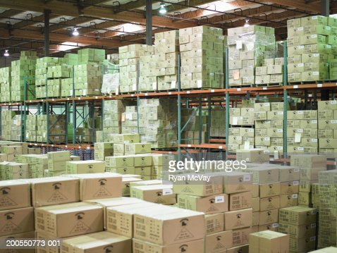 Stacks of cardboard boxes in warehouse : Stock Photo
