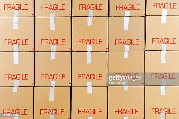 Stacks of cardboard boxes marked 'Fragile'