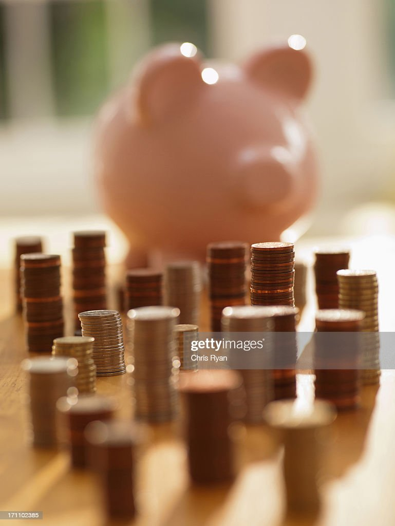 Stacks of coins and piggy bank : Stock Photo