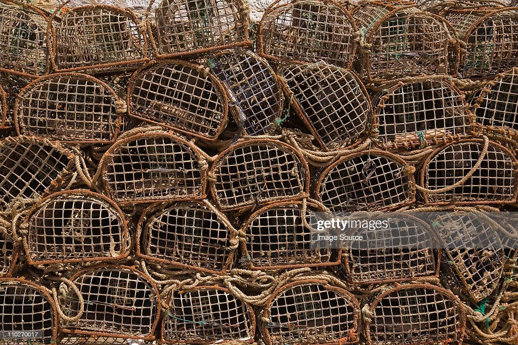 Stacks of commercial crab fishing baskets, Portugal