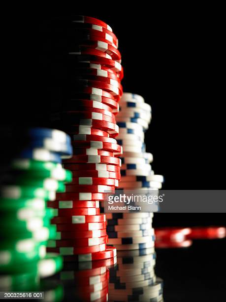 Stacks of gambling chips, close-up (focus on red chips)
