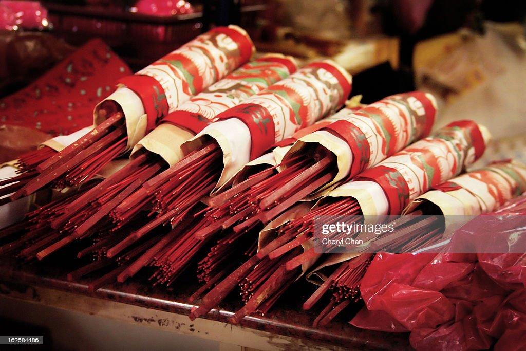 Stacks of joss sticks and joss papers : Stock Photo