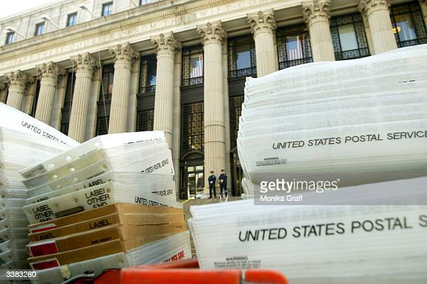 Stacks of mail trays lie outside the James A Farley Post Office April 15 2004 in New York City Completed income tax forms are due by midnight