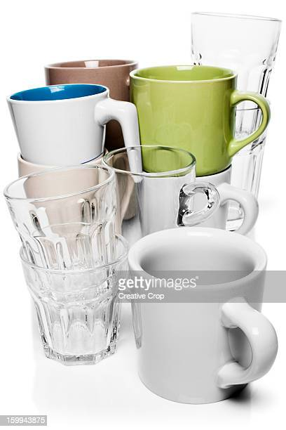 Stacks of mugs and drinking glasses
