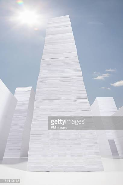 Stacks of paper against sky background
