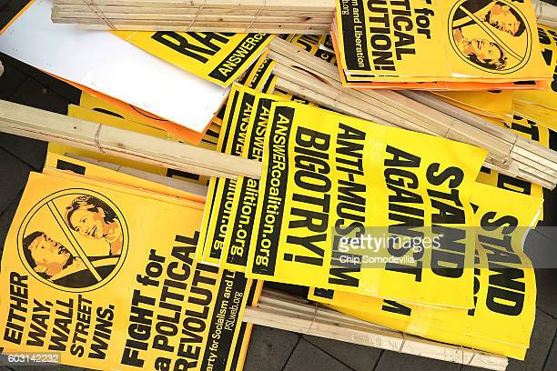 Stacks of protest signs are piled in front of the newly opened Trump International Hotel during a demonstration against Republican presidential...