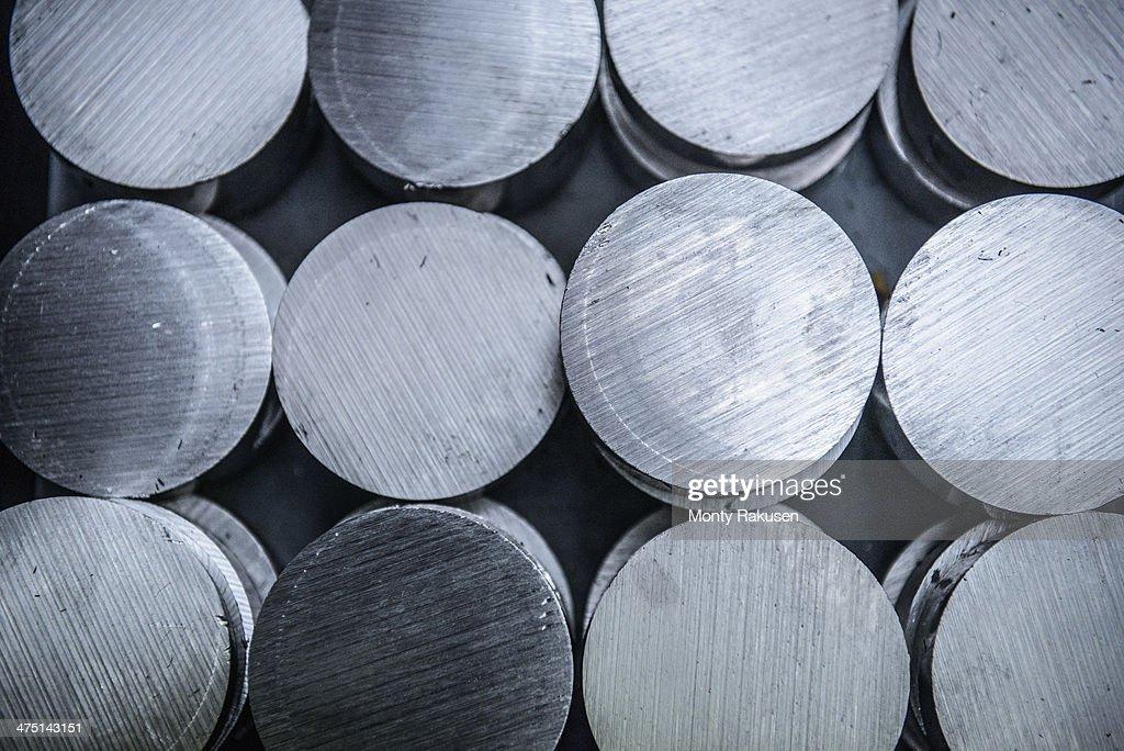 Stacks of raw and unworked steel discs in factory, overhead view