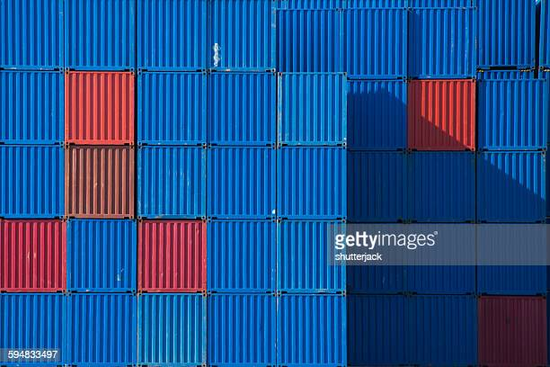 Stacks of shipping containers in a row