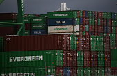Stacks of shipping containers sit at the Port of Oakland on February 6 2015 in Oakland California Pacific Maritime Association announced today that...