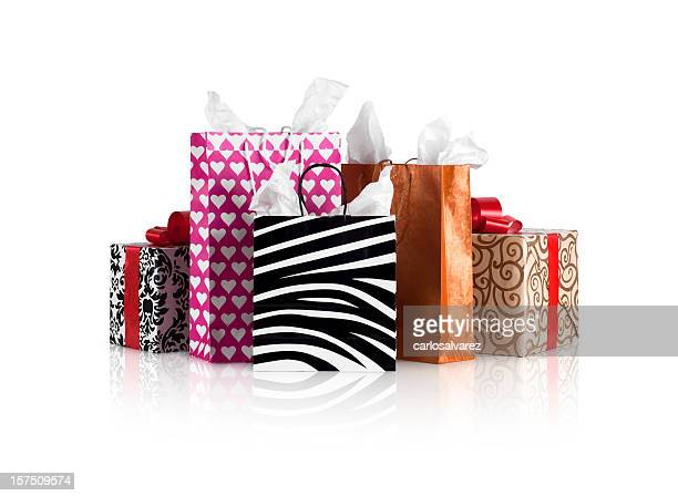 Stacks of shopping bags and gift boxes on a table