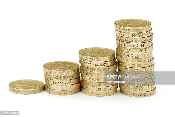 Stacks of thick coins with writing inscribed to their edges