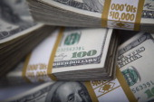 Stacks of US $100 bills are arranged for a photograph in New York US on Thursday Feb 7 2013 The US dollar advanced in trading today to the highest in...
