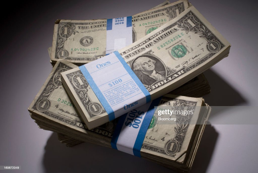Stacks of U.S. one-dollar bills are arranged for a photograph in New York, U.S., on Monday, Feb. 4, 2013. Stocks tumbled the most this year and the euro slid while Spanish bond yields surged amid renewed concern about Europe's debt crisis. Ten-year U.S. yields lost six basis points to 1.96 percent. Photographer: Scott Eells/Bloomberg via Getty Images