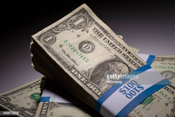Stacks of US onedollar bills are arranged for a photograph in New York US on Monday Feb 4 2013 Stocks tumbled the most this year and the euro slid...
