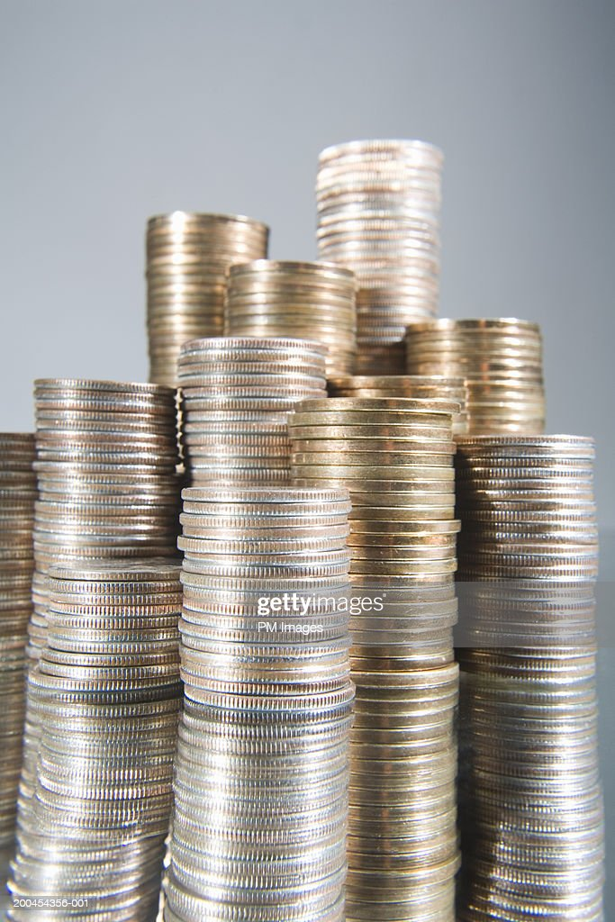 Stacks of USA coins on mirror : Stock Photo