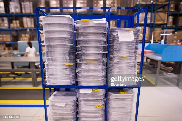 Stacks of vinyl records sit before being packaged and shipped at the Precision Record Pressing facility in Burlington Ontario Canada on Friday June...