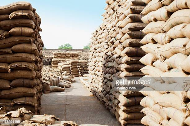 Stacks of wheat sacks in a warehouse, Anaj Mandi, Sohna, Gurgaon, Haryana, India