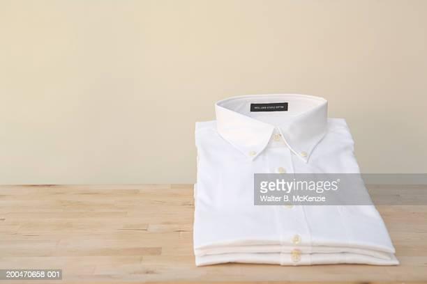 Stacks of white shirts
