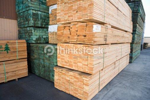 stacks of wood outside warehouse ストックフォト thinkstock