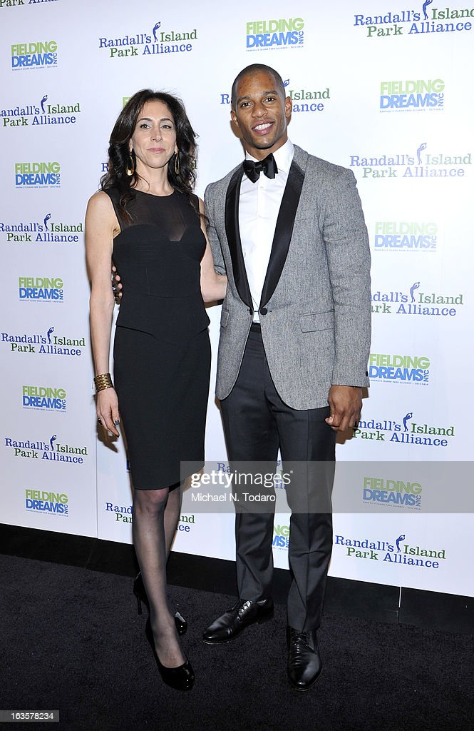 Stacy Bash-Polley and Victor Cruz attend the Randall's Island Park Alliance Fielding Dreams 2013 Gala at American Museum of Natural History on March 12, 2013 in New York City.