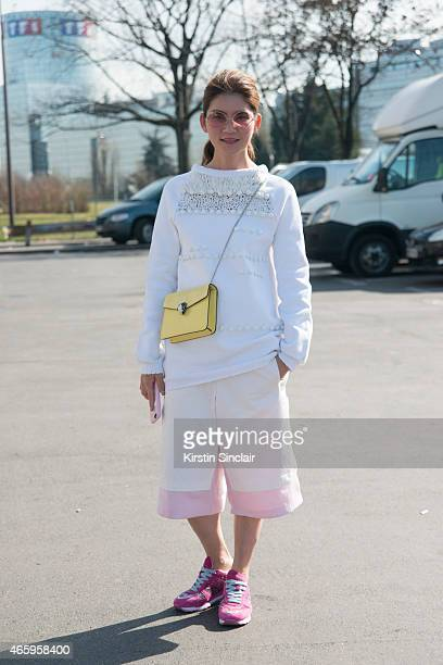 Stacy Chen wears Hogan shoes Bulgari bag Koche trousers and top and Massia sunglasses on day 6 of Paris Collections Women on March 08 2015 in Paris...
