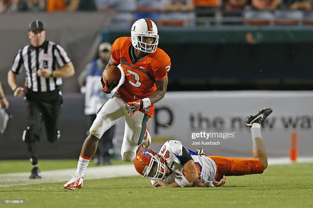 Stacy Coley #3 of the Miami Hurricanes eludes the tackle of Warren Sweet #46 of the Savannah State Tigers as he runs with the ball on September 21, 2013 at Sun Life Stadium in Miami Gardens, Florida. Miami defeated Savannah State 77-7.