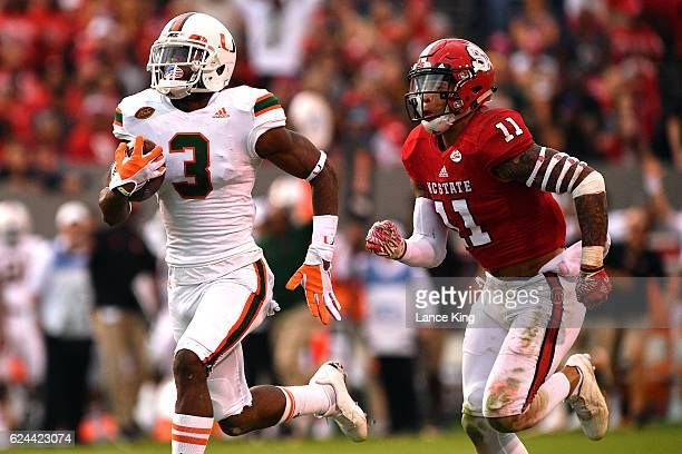 Stacy Coley of the Miami Hurricanes runs during his 51yard pass catch against Josh Jones of the North Carolina State Wolfpack at CarterFinley Stadium...