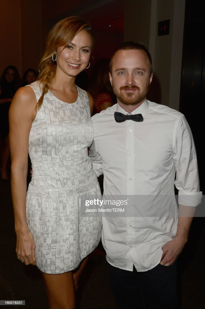 Stacy Keibler and actor <a gi-track='captionPersonalityLinkClicked' href=/galleries/search?phrase=Aaron+Paul&family=editorial&specificpeople=693211 ng-click='$event.stopPropagation()'>Aaron Paul</a> attend the Audi Forum New Orleans at the Ogden Museum of Southern Art on February 2, 2013 in New Orleans, Louisiana.