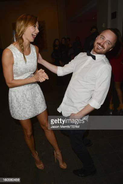 Stacy Keibler and actor Aaron Paul attend the Audi Forum New Orleans at the Ogden Museum of Southern Art on February 2 2013 in New Orleans Louisiana