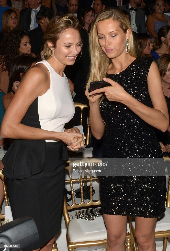Stacy Keibler (L) and Petra Nemcova attend the Pronovias bridal fashion show during Barcelona Bridal Week 2013 on May 3, 2013 in Barcelona, Spain.