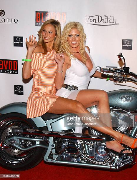 Stacy Keibler and Torrie Wilson from the WWE during Von Dutch Designer Christian Audigier's Birthday Celebration at Private residence in Hollywood...