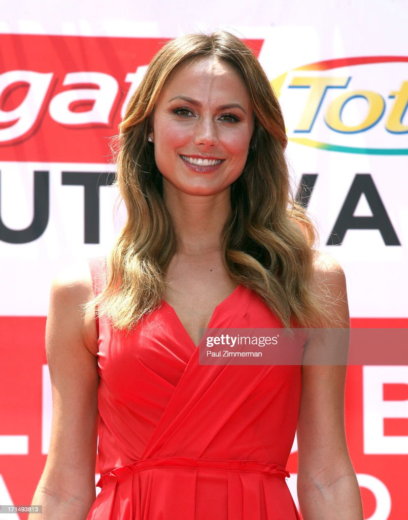 <a gi-track='captionPersonalityLinkClicked' href=/galleries/search?phrase=Stacy+Keibler&family=editorial&specificpeople=3031844 ng-click='$event.stopPropagation()'>Stacy Keibler</a> attends the launch of the new Colgate Total advanced Pro-Shield Mouthwash hosting 'A Wish for a Swish' at a special event to attempt to set a new Guinness World Record for the most people using mouthwash simultaneously at Times Square on June 25, 2013 in New York City.