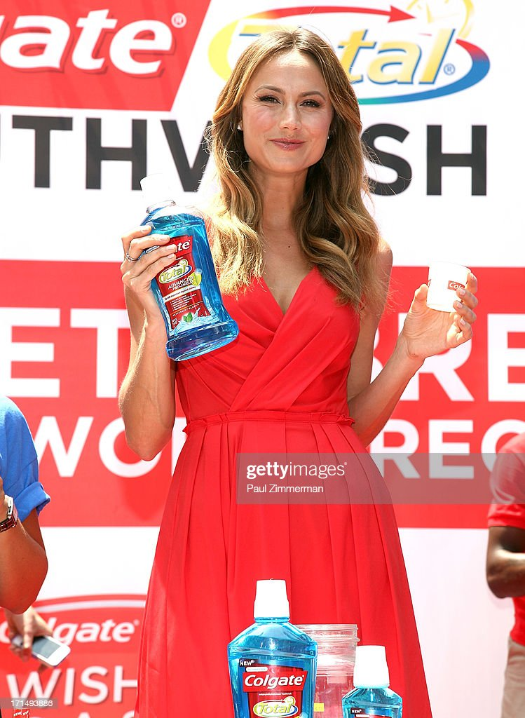 Stacy Keibler attends the launch of the new Colgate Total advanced Pro-Shield Mouthwash hosting 'A Wish for a Swish' at a special event to attempt to set a new Guinness World Record for the most people using mouthwash simultaneously at Times Square on June 25, 2013 in New York City.