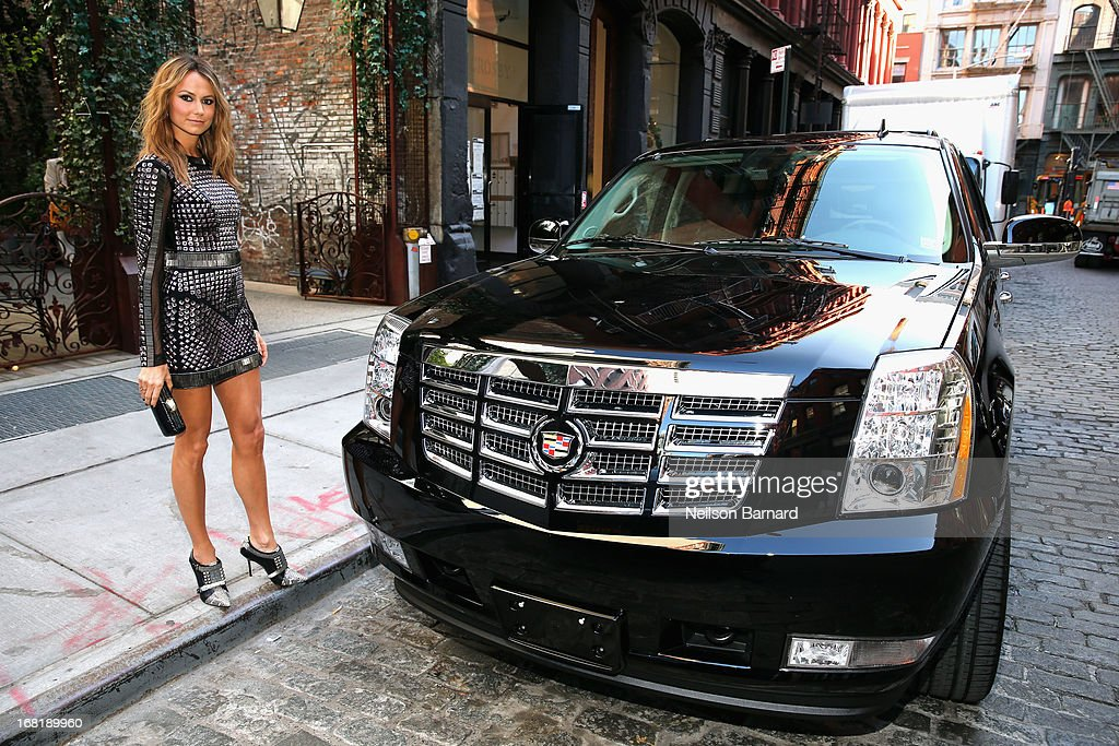 <a gi-track='captionPersonalityLinkClicked' href=/galleries/search?phrase=Stacy+Keibler&family=editorial&specificpeople=3031844 ng-click='$event.stopPropagation()'>Stacy Keibler</a> poses in a Rachel Roy design, headed to The Costume Institute Gala in a Cadillac Escalade on May 6, 2013 in New York City.