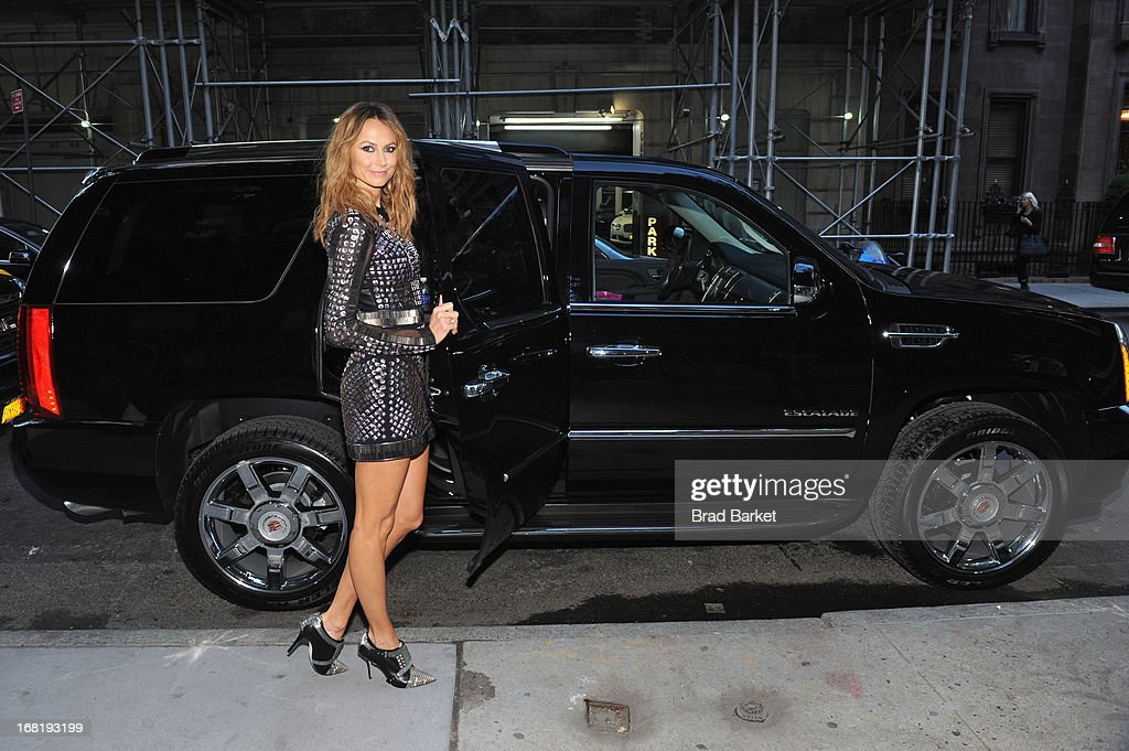 Stacy Keibler, wearing a Rachel Roy original, climbs into her Cadillac Escalade on May 6, 2013 in New York City.