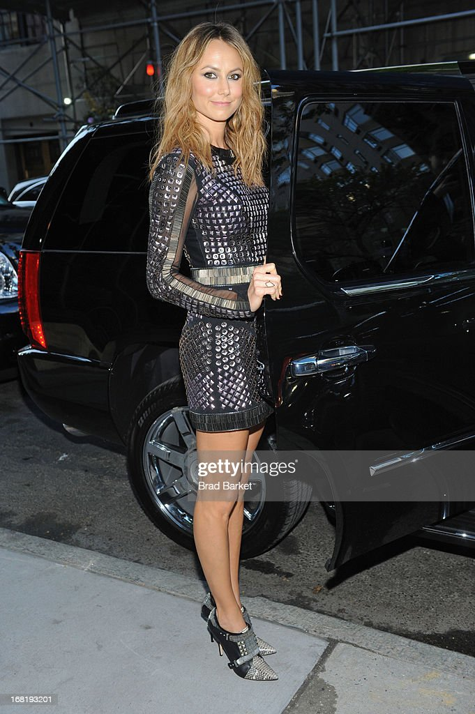 <a gi-track='captionPersonalityLinkClicked' href=/galleries/search?phrase=Stacy+Keibler&family=editorial&specificpeople=3031844 ng-click='$event.stopPropagation()'>Stacy Keibler</a>, wearing a Rachel Roy original, climbs into her Cadillac Escalade on May 6, 2013 in New York City.