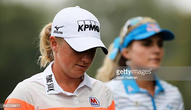 Stacy Lewis and Lexi Thompson of the USA walk off the third tee during the final round of the Lorena Ochoa Invitational Presented by Banamex at the...