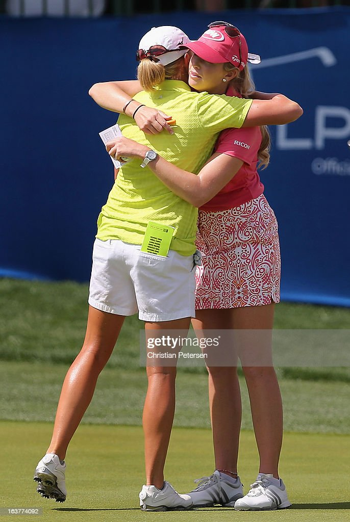 Stacy Lewis and Paula Creamer hug on the ninth hole green following the second round of the RR Donnelley LPGA Founders Cup at Wildfire Golf Club on March 15, 2013 in Phoenix, Arizona.