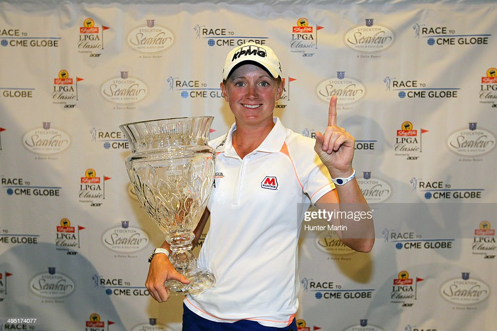 <a gi-track='captionPersonalityLinkClicked' href=/galleries/search?phrase=Stacy+Lewis+-+Golfer&family=editorial&specificpeople=4217318 ng-click='$event.stopPropagation()'>Stacy Lewis</a> holds the championship trophy and signifies her number one ranking as the top ranked female golfer in the world after winning the ShopRite LPGA Classic presented by Acer on the Bay Course at the Stockton Seaview Hotel & Golf Club on June 1, 2014 in Galloway, New Jersey.