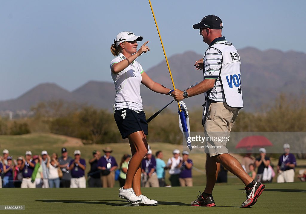 <a gi-track='captionPersonalityLinkClicked' href=/galleries/search?phrase=Stacy+Lewis+-+Golfer&family=editorial&specificpeople=4217318 ng-click='$event.stopPropagation()'>Stacy Lewis</a> hugs her caddie <a gi-track='captionPersonalityLinkClicked' href=/galleries/search?phrase=Travis+Wilson+-+Golf+Caddy&family=editorial&specificpeople=15147345 ng-click='$event.stopPropagation()'>Travis Wilson</a> after winning the RR Donnelley LPGA Founders Cup at Wildfire Golf Club on March 17, 2013 in Phoenix, Arizona.