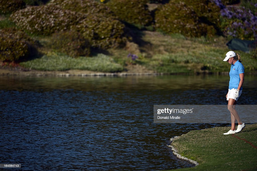 Stacy Lewis loses her tee shot into the water hazard on the 18th fairway during the Final Round of the LPGA 2013 Kia Classic at the Park Hyatt Aviara Resort on March 24, 2013 in Carlsbad, California.