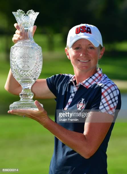 Stacy Lewis of Team USA holds the Solheim Cup trophy after the final day singles matches of The Solheim Cup at Des Moines Golf and Country Club on...