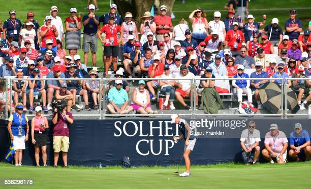 Stacy Lewis of Team USA holes a putt during the final day singles matches of The Solheim Cup at Des Moines Golf and Country Club on August 20 2017 in...
