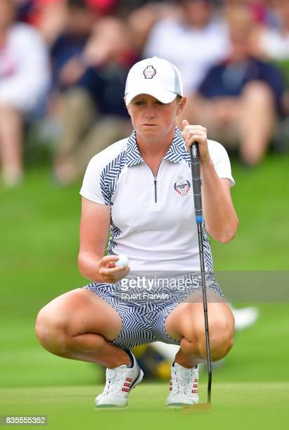 Stacy Lewis of Team USA lines up a putt during the second day morning foursomes matches of The Solheim Cup at Des Moines Golf and Country Club on...
